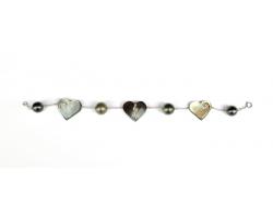 Perles de Tahiti et coeurs en bracelet