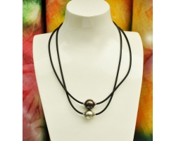 "Rubber necklace ""Ta'aroa"" and one tahitian pearl."
